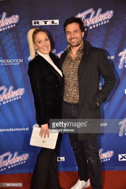 04 December 2019 North RhineWestphalia Cologne Actors Janine Kunze lr and Kai Schumann come to the premiere and tour kickoff of Flashdance The...