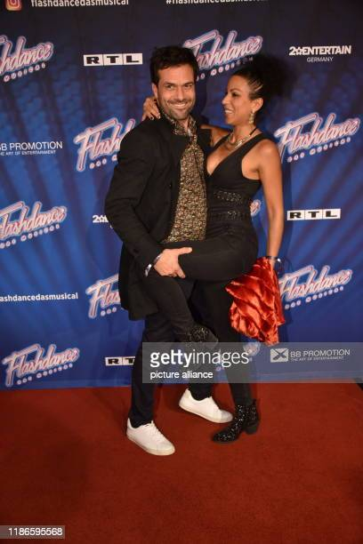 """December 2019, North Rhine-Westphalia, Cologne: Actors Kai Schumann and Marva Schreiber come to the premiere and tour kick-off of """" Flashdance - The..."""