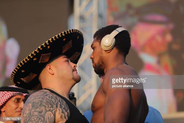 USMexican professional boxer Andy Ruiz Jr and Britain's Anthony Joshua stare at each other down at WeighIn in Al Faisaliah Hotel ahead of their...