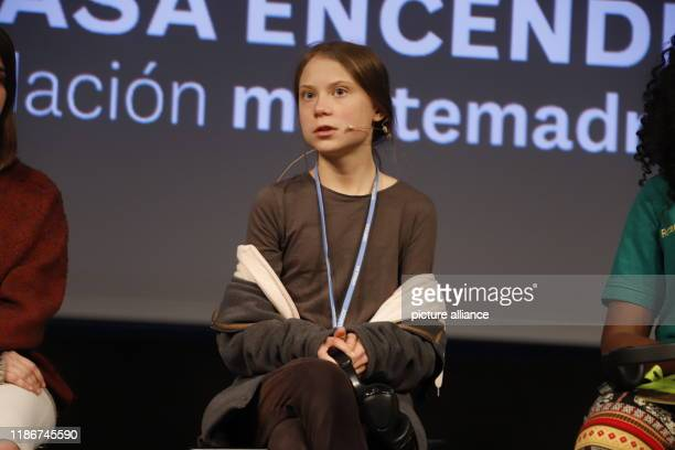 December 2019, Spain, Madrid: Greta Thunberg, climate activist from Sweden, talks to other young activists at a press conference. Thunberg is to make...
