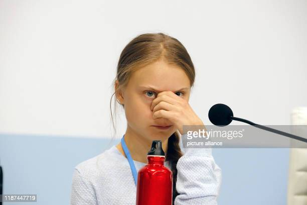 December 2019, Spain, Madrid: Greta Thunberg, Swedish climate activist, sits at an event at the UN Climate Change Conference. Photo: Clara Margais/dpa