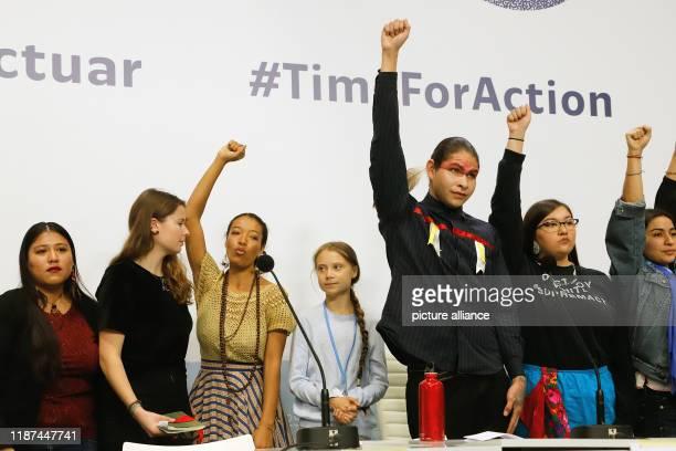 December 2019, Spain, Madrid: Greta Thunberg , Swedish climate protection activist, and Luisa Neubauer , German climate protection activist, are...