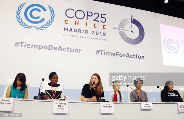 December 2019, Spain, Madrid: Luisa Neubauer , German climate activist, and Greta Thunberg , Swedish climate activist, sit on the podium at the UN...