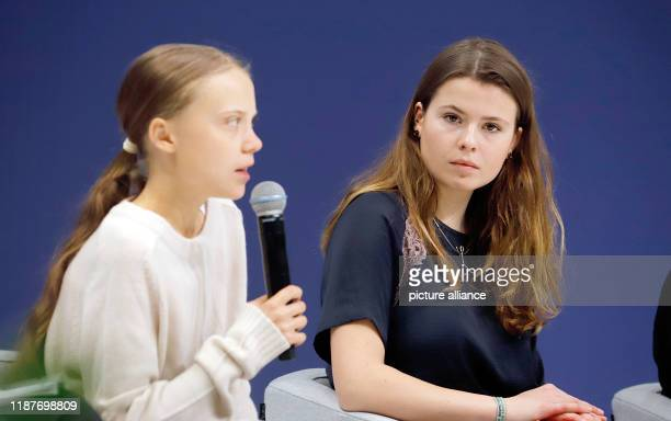 December 2019, Spain, Madrid: Luisa Neubauer , German climate activist, and Greta Thunberg, Swedish climate activist, address an event at the UN...