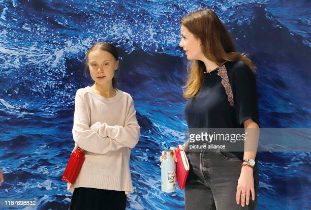 December 2019, Spain, Madrid: Luisa Neubauer , German climate activist, and Greta Thunberg, Swedish climate activist, take part in an event at the UN...