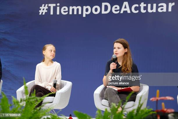 December 2019, Spain, Madrid: Luisa Neubauer , German climate activist, and Greta Thunberg, Swedish climate activist, are at an event at the UN...