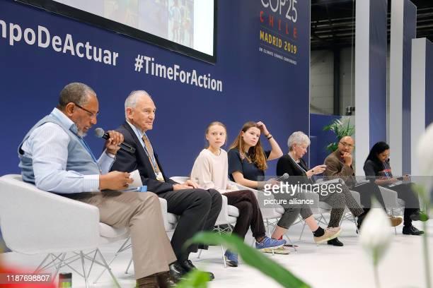 December 2019, Spain, Madrid: Luisa Neubauer , German climate protection activist, and Greta Thunberg , Swedish climate protection activist, sit at...
