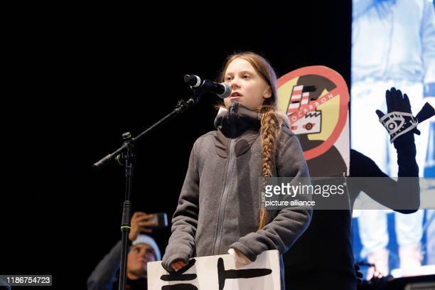 December 2019, Spain, Madrid: The Swedish climate activist Greta Thunberg speaks at the climate march during the COP25 U.N. Climate Conference 2019....