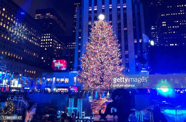 December 2019, US, New York: The Christmas tree at Rockefeller Center shines brightly and brightly in the glow of lights, after the ceremony to turn...