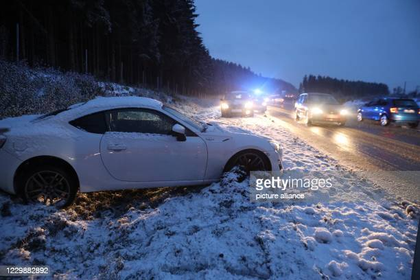 December 2020, Baden-Wuerttemberg, Dreißlingen: A car is lying in the ditch near Deißlingen after a slippery accident on the B27. The driver was not...