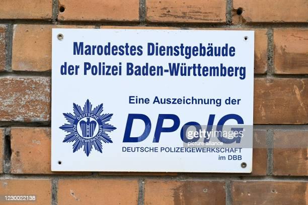 """December 2020, Baden-Wuerttemberg, Ravensburg: A sign with the inscription """"Marodestes Dienstgebäude der Polizei Baden-Württemberg - Eine..."""