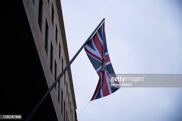 December 2020, Berlin: A flag hangs at the British Embassy. The European Union and Britain have moved towards a deal in the dispute over a Brexit...