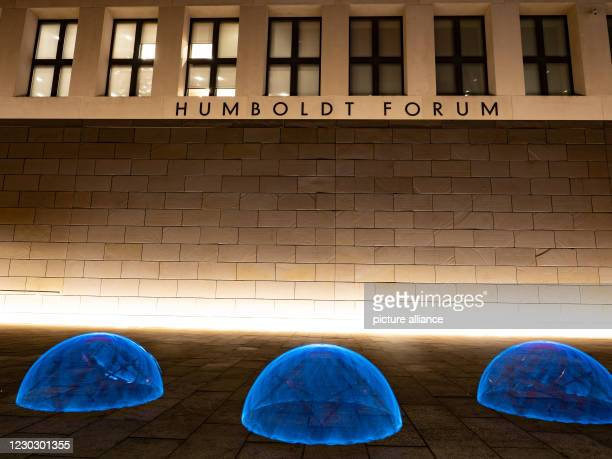 December 2020, Berlin: A staged play of light, recorded with long exposure, creates hemispherical traces of light in front of the Humboldt Forum....