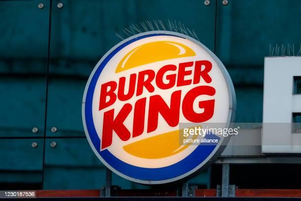 """December 2020, Berlin: The logo of the """"Burger King"""" store at Alexanderplatz. Photo: Gerald Matzka/dpa-Zentralbild/ZB"""