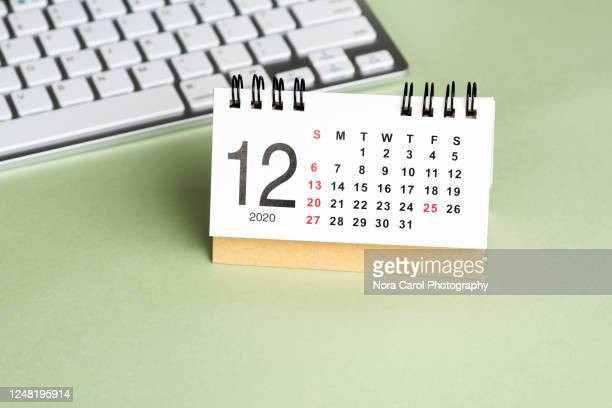 december 2020 calendar on green background - december stock pictures, royalty-free photos & images