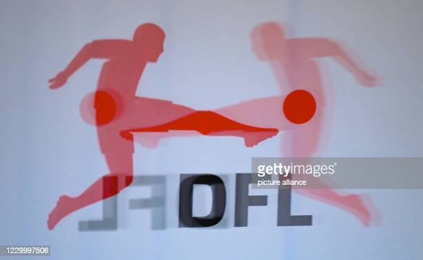 December 2020, Hessen, Frankfurt/Main: The logo of the DFL German Football League is reflected in a plexiglass panel before a press conference...