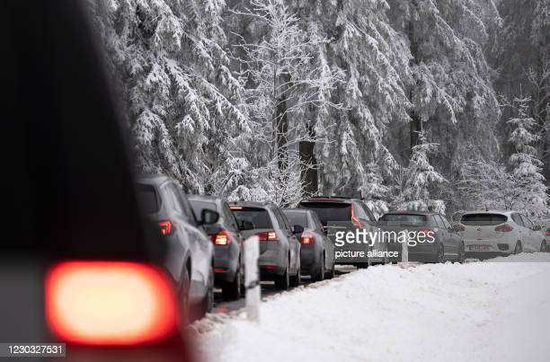 December 2020, North Rhine-Westphalia, Winterberg: Vehicles jam up the road to the Kahler Asten. Already on Sunday there were long traffic jams,...