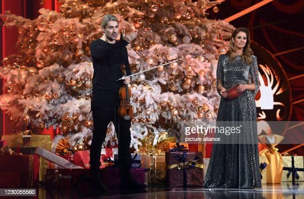 December 2020, Saxony, Leipzig: The German violinist David Garrett talks to presenter Mareille Höppner during the José Carreras Gala in Leipzig. The...
