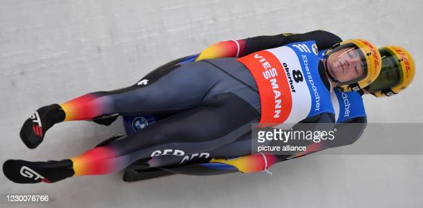 December 2020, Thuringia, Oberhof: Hannes Orlamünder and Paul Gubitz from Germany in the men's double-seater in the track at the Eberspächer Luge...