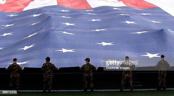 December 21, 2006 - Airmen present a 100-yard-by-50-yard American Flag during the National Anthem at the Pioneer PureVision Las Vegas Bowl.