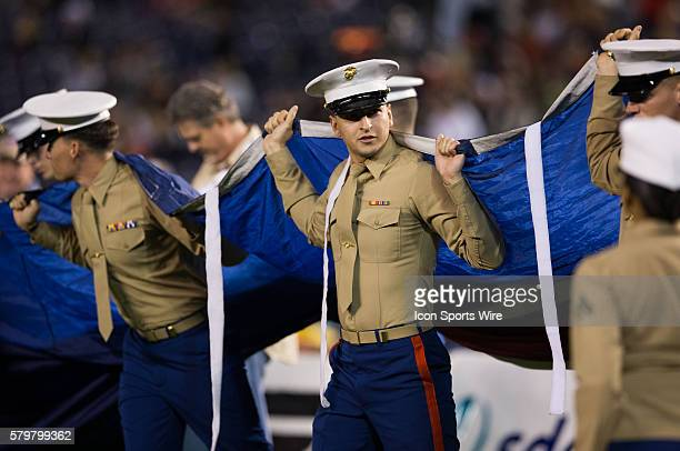 December 23 2014 Marines hold the giant American Flag during the Poinsettia Bowl game between San Diego State Aztecs and Navy Midshipmen at Qualcomm...