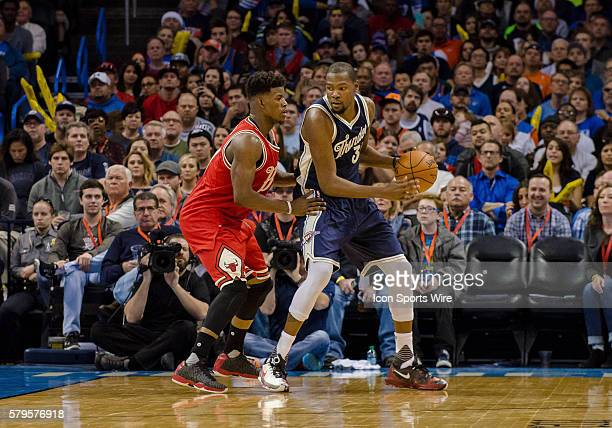 Oklahoma City Thunder Forward Kevin Durant [1864] looks to score versus Chicago Bulls Guard Jimmy Butler [3045] at Chesapeake Energy Arena in...
