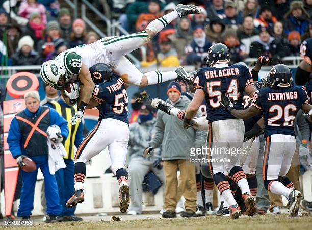 New York Jets at Chicago Bears at Soldier Field in Chicago IL NY Jets lose to the Chicago Bears 3834 #81 Dustin Keller flys through the air during...