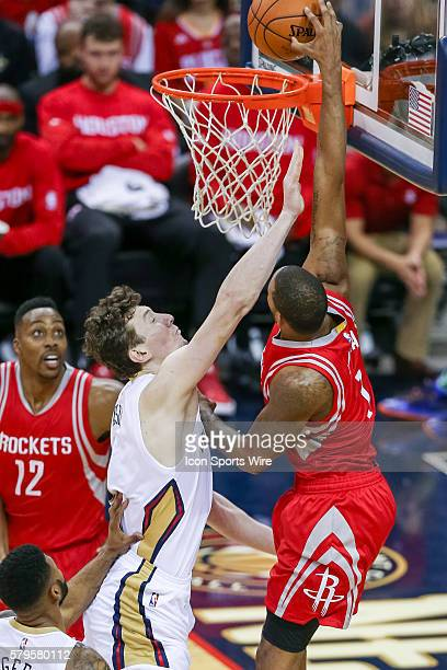 Houston Rockets forward Trevor Ariza dunks the ball against New Orleans Pelicans center Omer Asik during the game between the New Orleans Pelicans...