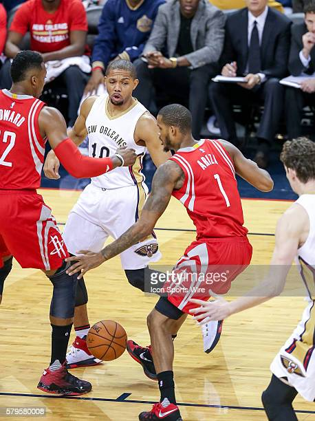 New Orleans Pelicans guard Eric Gordon passes the ball through Houston Rockets forward Trevor Ariza during the game between the New Orleans Pelicans...