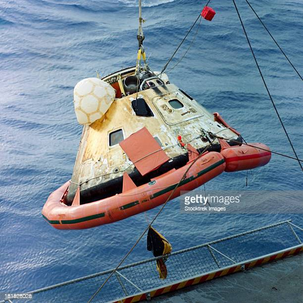 december 27, 1968 - the apollo 8 capsule is seen being hoisted aboard the recovery carrier, uss yorktown after its successful splashdown.  - apollo 8 stock pictures, royalty-free photos & images