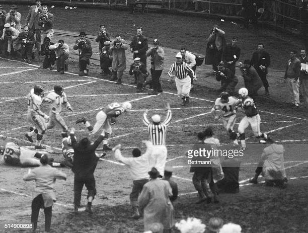 December 27 Baltimore Maryland Baltimore fans jump for joy photographers in background snap their shutters as quarterback Johnny Unitas of the Colts...