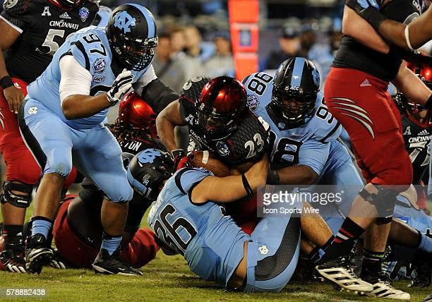 Cincinnati Bearcats running back Hosey Williams tackled on the play by North Carolina Tar Heels defensive end Justin Thomason and defensive back Ryan...