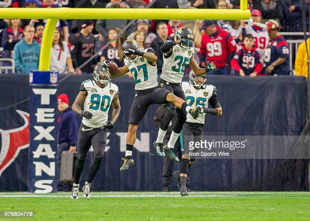 Jacksonville Jaguars Cornerback Dwayne Gratz celebrates his interception with Jacksonville Jaguars Cornerback Demetrius McCray during the NFL game...