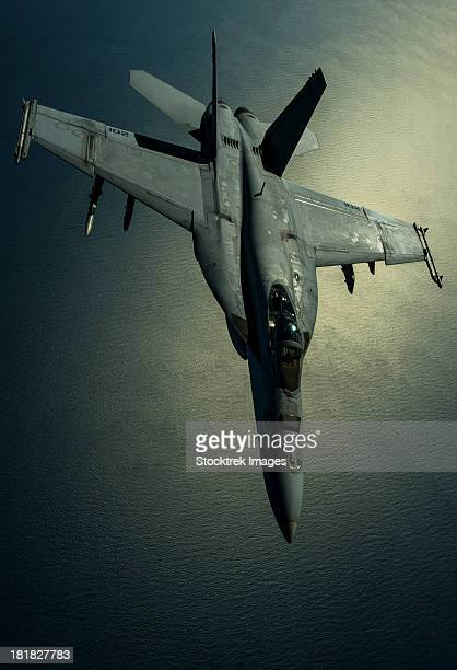 december 29, 2012 - a u.s. navy f/a-18e hornet breaks away after refueling from a u.s. air force kc-135r stratotanker over southwest asia.  - asian hornet stock pictures, royalty-free photos & images