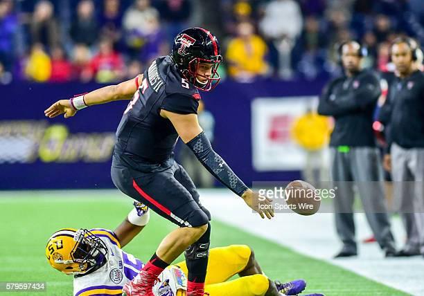 LSU Tigers linebacker Deion Jones knocks the ball free from Texas Tech Red Raider quarterback Patrick Mahomes during the 2015 Advocare Texas Bowl...