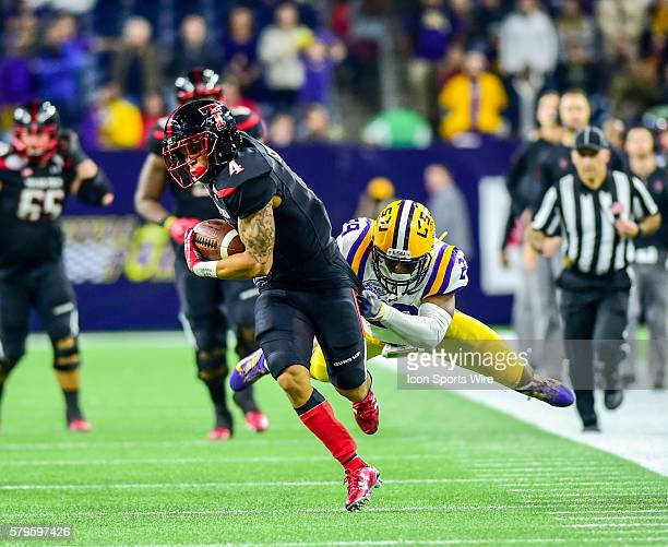 LSU Tigers safety Rickey Jefferson catches Texas Tech Red Raider running back Justin Stockton from behind during the 2015 Advocare Texas Bowl...