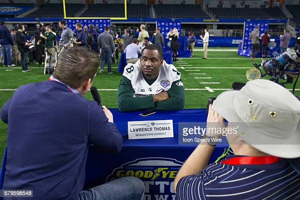 Michigan State Spartans Lawrence Thomas interviewed during the NCAA Football Playoff Semifinal Cotton Bowl media day at ATT Stadium in Arlington Texas