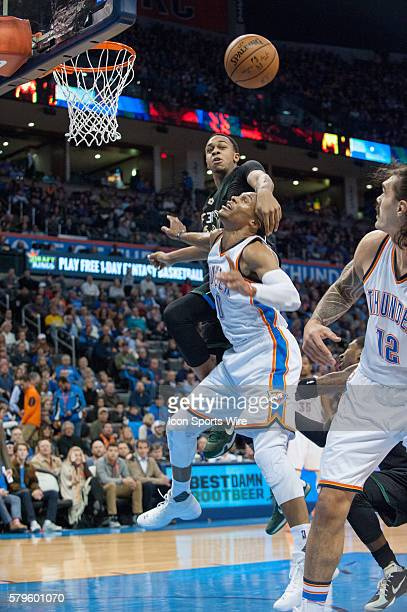 Oklahoma City Thunder Guard Russell Westbrook [1973] gets fouled by Milwaukee Bucks Center John Henson [3253] in game at Chesapeake Energy Arena in...