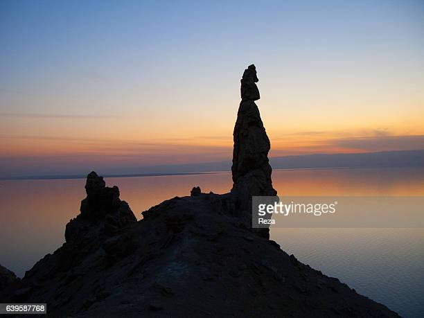 December 29 Southern shore of the Dead Sea AlKarak Governorate JordanrnStatue of Lot's wife at dusk According to the legend the column made of salt...