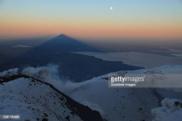 december 3, 2009 - villarrica, summit view with shadow at sunrise, araucania region, chile. - villarrica stock photos and pictures