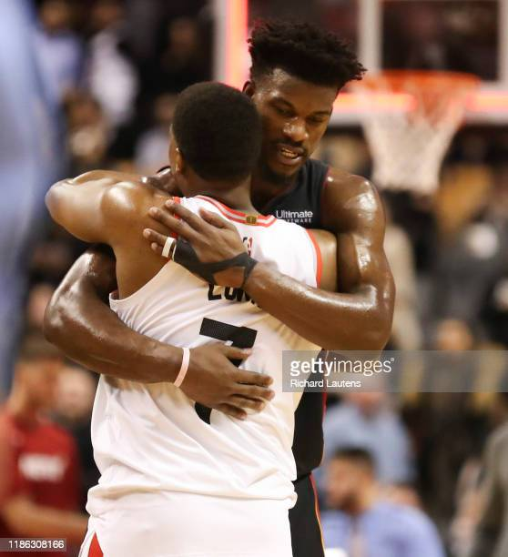 December 3 After the buzzer, Toronto Raptors guard Kyle Lowry gets a hug from Miami Heat forward Jimmy Butler The Toronto Raptors lost to the Miami...