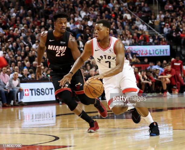 TORONTO ON December 3 In the first half Toronto Raptors guard Kyle Lowry works the ball up the court around Miami Heat forward Jimmy Butler The...