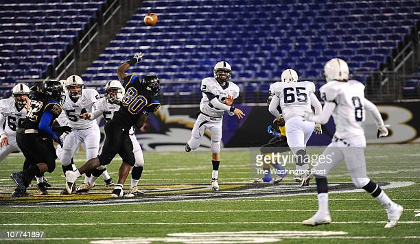 Urbana QB Michael Spahr throws a pass to WR Aaron Bing for a first down setting up their only touchdown of the game against Wise on December 3 2010...