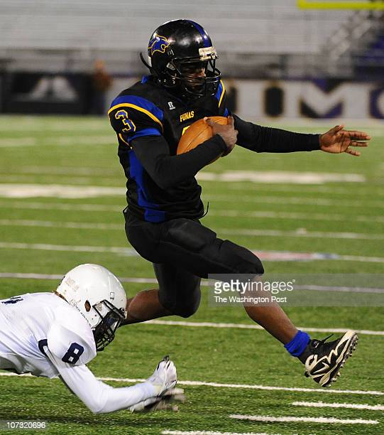 Wise QB DeAndre' Smith leaps out of the grasp of Urbana DB Aaron Bing during 3rd quarter action on December 3 2010 in Baltimore Md {Photo by Jonathan...