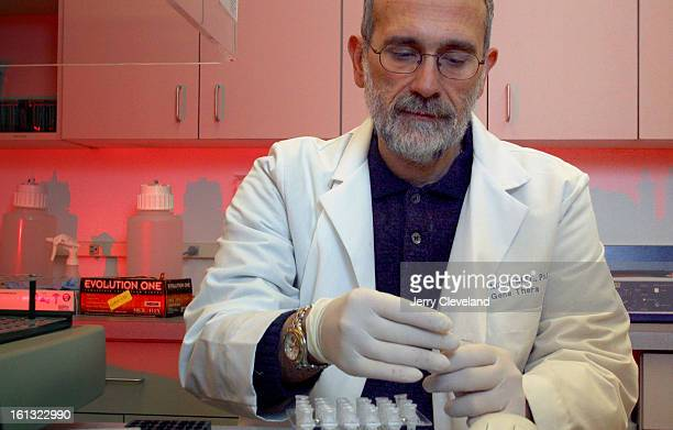 RIDGE COLO December 30 2003 Dr Antonio Milici <cq> CEO of GeneThera Inc <cq> works in one of the company's Wheat Ridge Colo labs Tuesday afternoon...