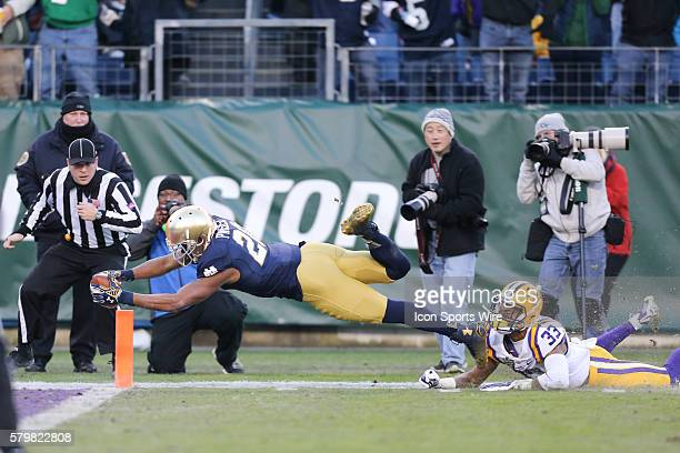 Notre Dame Fighting Irish wide receiver CJ Prosise gets the ball across the plane for a score during the 2014 Franklin American Mortgage Music City...
