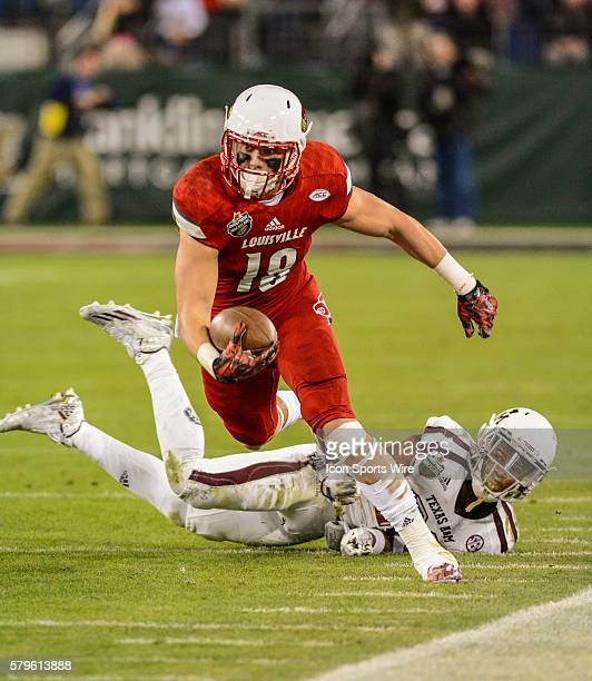 Cole Hikutini catches the ball in the Franklin American Mortgage Music City Bowl between the Texas AM Aggies and Louisville Cardinals at Nissan...