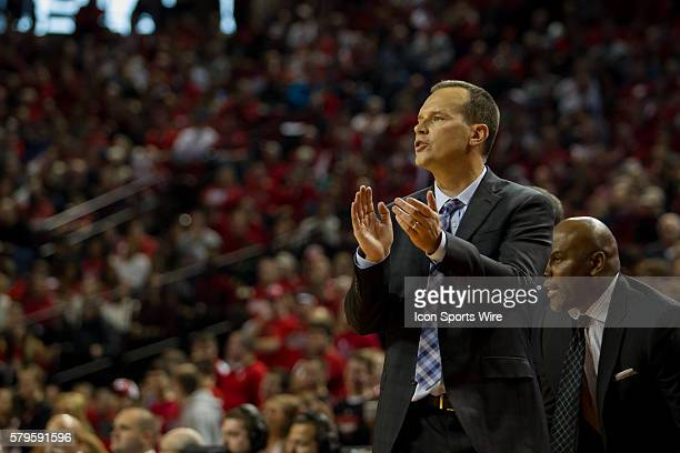 head coach Chris Collins of the Northwestern Wildcats encouraging his players during the second half against the Nebraska Cornhuskers at the Pinnacle...