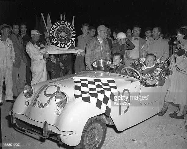 Codrivers Fritz Koster and Ralph Deshon celebrate in victory lane at Sebring International Raceway after driving a Crosley Hot Shot to victory in the...