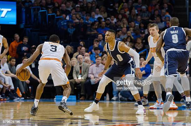 Oklahoma City Thunder Guard Russell Westbrook [1973] plays defense on Phoenix Suns Guard Brandon Knight [3043] at Chesapeake Energy Arena in Oklahoma...